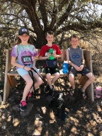 3 kids on a bench